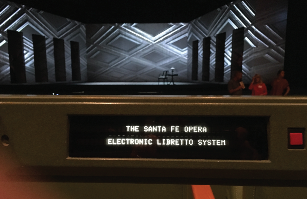 An opera stage with a digital screen.